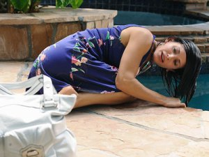 Jules, Cougar Town, hungover and dunking her head in the swimming pool