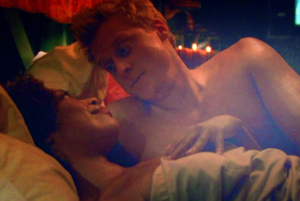 Gina Torres and Alan Tudyk as post-coital Zoe and Wash, Firefly