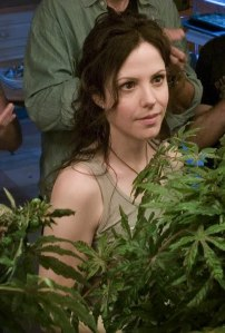 Nancy in the grow house surrounded by weed, Weeds