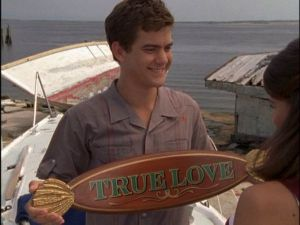 Pacey holding up boat sign saying True Love to Joey
